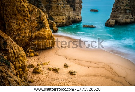 Mountain sea beach view. Sand beach at mountain sea. Mountain blue lagoon beach. Sand beach rocks #1791928520