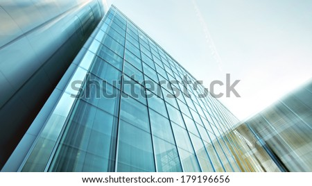 Panoramic and perspective wide angle view to steel light blue background of glass highrise building skyscraper, modern futuristic commercial city Business concept of successful industrial architecture #179196656