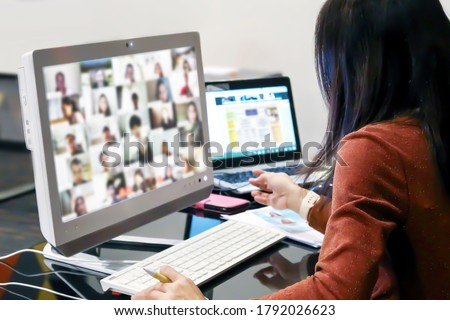 Office women using computer laptop for online meetings or online elearning or teaching students with webex or zoom program application. Royalty-Free Stock Photo #1792026623