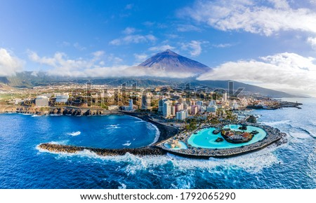 Aerial view with Puerto de la Cruz, in background Teide volcano, Tenerife island, Spain  #1792065290
