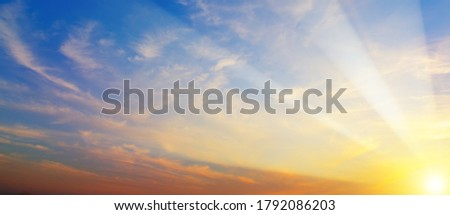 Beautiful sunrise. Blue sky and golden clouds. Wide photo. #1792086203