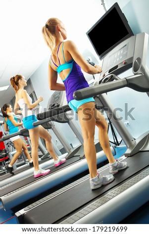 Image of fitness girl running on treadmill #179219699