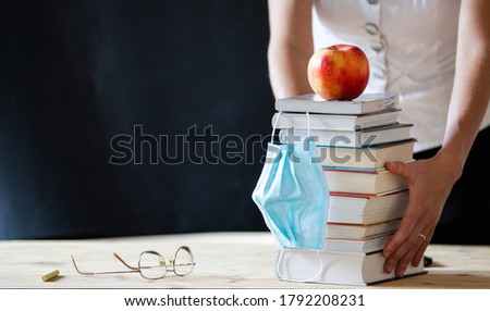 back to school during covid pandemics teacher with face mask #1792208231
