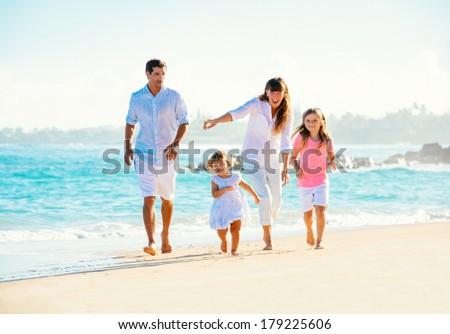 Happy family having fun walking on the beach #179225606