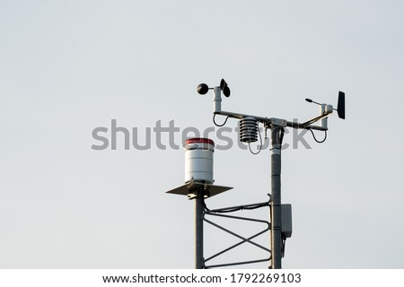 Anemometer on sky background, wind speed indicator equipment technology #1792269103