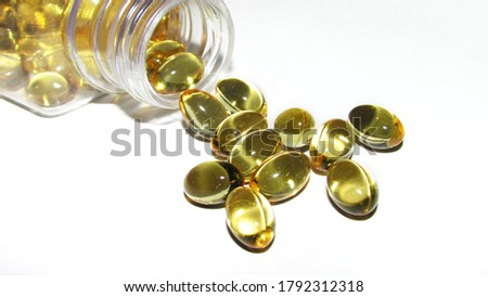 Cod liver oil  or fish oil gel capsules  on white background. It contains omega 3 fatty acids , EPA,  DHA