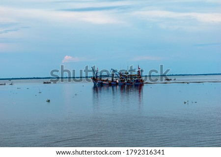 Fishing boats in Pattani Province, Thailand and the letters are the name of the boat and the code of the Department of Fisheries.