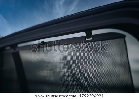 Car side window curtains sunshades with insect screen Royalty-Free Stock Photo #1792396921