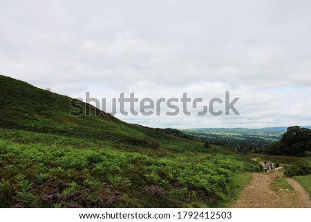 walking hiking trail through rolling hills of ilkley moor in west yorkshire england #1792412503