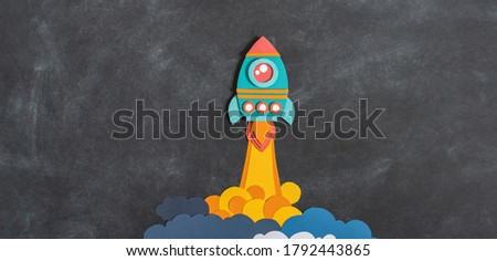 Rocket takes off paper craft. Back to school. Copy space. Black background school board. Business concept Banner Copy space