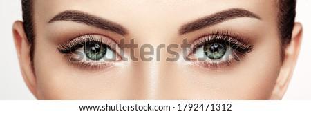 Female Eye with Extreme Long False Eyelashes. Eyelash Extensions. Makeup, Cosmetics, Beauty. Close up, Macro #1792471312