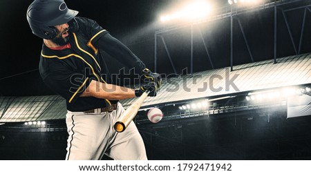 Porfessional baseball player with bat taking a swing on grand arena. Ballplayer on stadium in action. Royalty-Free Stock Photo #1792471942