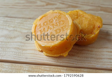 Two blocks of home made soap on a wooden background. Hand made soap with natural ingredients concept, high angle view. Copyspace to left. Royalty-Free Stock Photo #1792590628