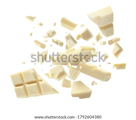 Chocolate explosion, pieces shattering on white background #1792604380