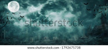 Zombie rising out of graveyard cemetery and church In Spooky scary dark Night full moon bats on tree. Holiday event halloween banner background concept.