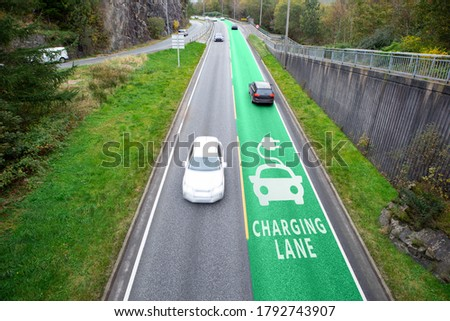 Road with lane for wireless charging of electric vehicles Royalty-Free Stock Photo #1792743907