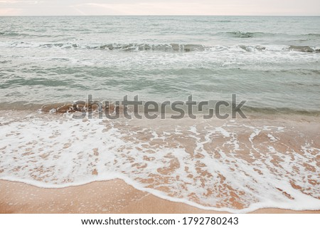 neutral sea ocean background with waves. Photos with a neutral color palette Royalty-Free Stock Photo #1792780243