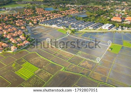 Land plot in aerial view. Include landscape, cultivate area, agricultural plant, pin location icon. For plantation, housing subdivision, residential, development, owned, sale, rent, buy or investment. Royalty-Free Stock Photo #1792807051