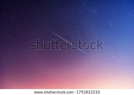 Satellite flight near Alpha Aurigae or Capella star in the night sky. #1792822210