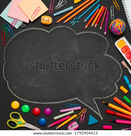 School multi-colored supplies, pencils and a drawn cloud with copy space for text. The concept back to school of a new school year.