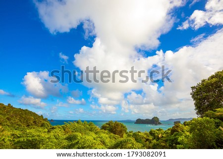 Incredible clouds over the evening tide. Pacific Ocean, New Zealand. Road to the Cathedral Cove on the North Island. The concept of active, exotic, ecological and photo tourism