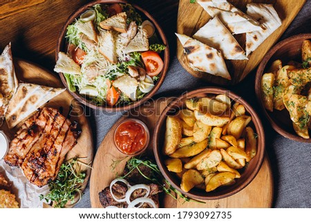 delicious European and Slavic cuisine on the big table waiting for guests. table with food, top view Royalty-Free Stock Photo #1793092735