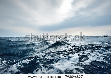 Glowing clouds above the open Baltic sea before the thunderstorm. Sweden Dramatic sky, epic seascape. A view from the yacht. Sailing in a rough weather Royalty-Free Stock Photo #1793096827