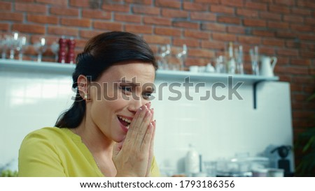 Portrait of happy businesswoman rejoicing at home office. Joyful female freelancer laughing in kitchen. Closeup surprised business woman applauding in modern kitchen in slow motion. Royalty-Free Stock Photo #1793186356