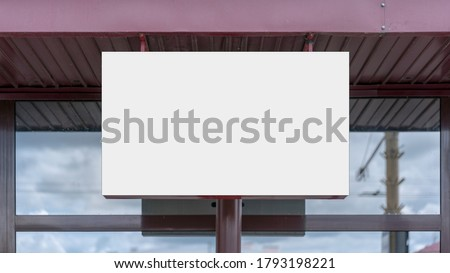 white blank display with empty mock-up on glass window of store building facade front view