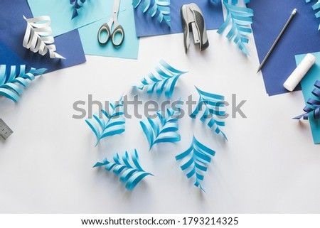 How to make paper beautiful Christmas toy snowflake to decorate room with children at home. Step by step instructions. Hands making DIY winter craft project. Step 9. Make six parts of snowflakes Royalty-Free Stock Photo #1793214325