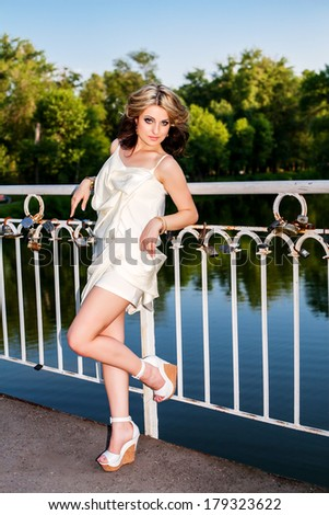 beautiful young girl on nature  #179323622
