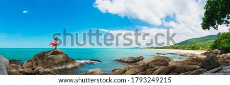 Wide panorama traveler woman in dress stand on rock joy nature scenic landscape Sichon beach, Panoramic view tourist travel thailand summer holiday vacation, Tourism beautiful destinations place Asia Royalty-Free Stock Photo #1793249215