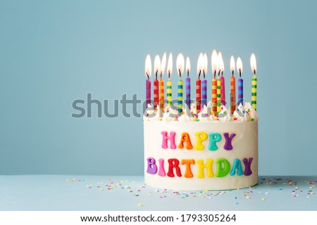 Rainbow happy birthday cake with colorful candles Royalty-Free Stock Photo #1793305264