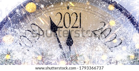 Countdown to midnight. Retro style clock counting last moments before Christmas or New Year 2021. Royalty-Free Stock Photo #1793366737