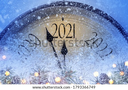 Countdown to midnight. Retro style clock counting last moments before Christmas or New Year 2021. #1793366749