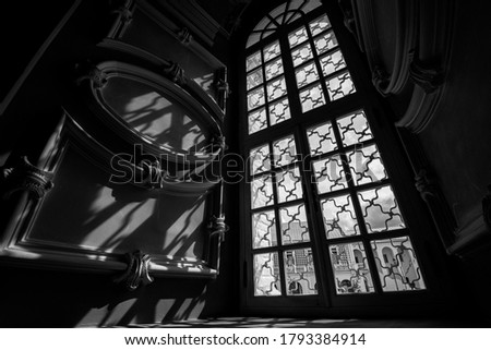 Interior of orthodox church, baroque style with window, shadows and sun light, black and white picture