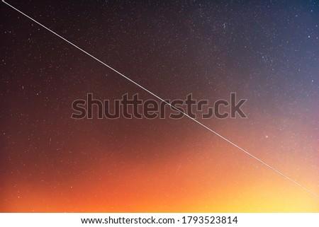 Satellite flight near Alpha Aurigae or Capella star in the night sky. #1793523814