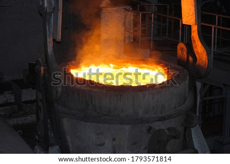 Steel production in electric furnaces. Sparks of molten steel. Electric arc furnace shop EAF. Metallurgical production, heavy industry, engineering, steelmaking #1793571814