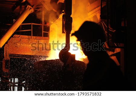 Steel production in electric furnaces. Sparks of molten steel. Electric arc furnace shop EAF. Metallurgical production, heavy industry, engineering, steelmaking #1793571832