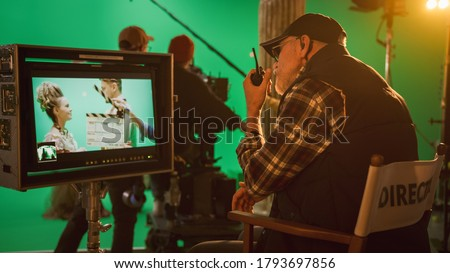 Director Gives Commands Shooting History Movie Green Screen CGI Scene with Actors Wearing Renaissance Costumes. Big Film Studio Professional Crew Shooting Big Budget Movie. Back View Shot Royalty-Free Stock Photo #1793697856