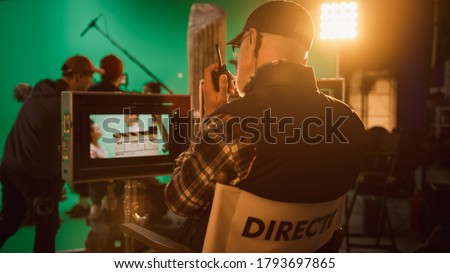Director Gives Commands Shooting History Movie Green Screen CGI Scene with Actors Wearing Renaissance Costumes. Big Film Studio Professional Crew Shooting Big Budget Movie. Back View Shot Royalty-Free Stock Photo #1793697865