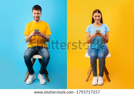 People Lifestyle Concept. Casual woman and man sitting on chairs and using their smart phones Royalty-Free Stock Photo #1793717257