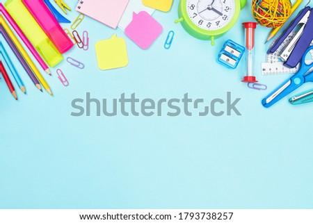 back to school stationery on blue background school, university, copy space