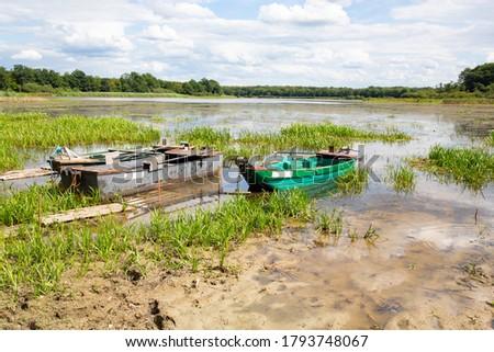 Fishing boat on the shore of Étang de Gondrexange in Lorraine, France #1793748067