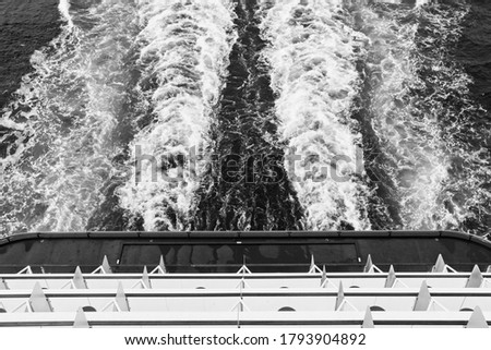 A cruise ship's wake. Travel background image.