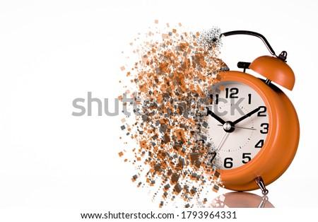 Dissolving orange alarm clock. Dissolving time