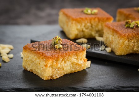 Delicious traditional turkish food baklava with honey and nuts. Oriental sweets with pistachio. Turkish Ramadan dessert. Pahlava Royalty-Free Stock Photo #1794001108