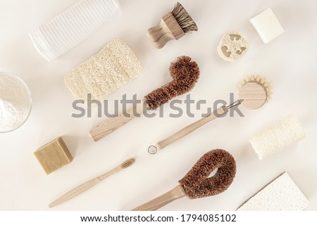 Zero waste kitchen cleaning concept. Eco friendly natural cleaning tools and products, bamboo dish brushes and lemon with baking soda. No plastic, eco-friendly lifestyle. Top view, flat lay. Royalty-Free Stock Photo #1794085102