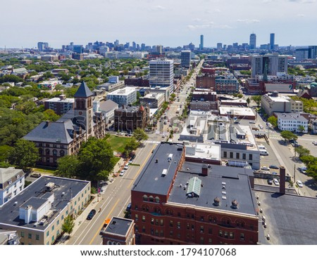 Cambridge City Hall aerial view with the Boston skyline at the background on Massachusetts Avenue in downtown Cambridge, Massachusetts MA, USA.