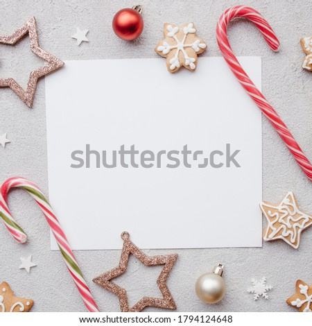 Christmas and New Year background. Composition of festive sweets and decorations with copy space. Winter holidays greeting card mockup